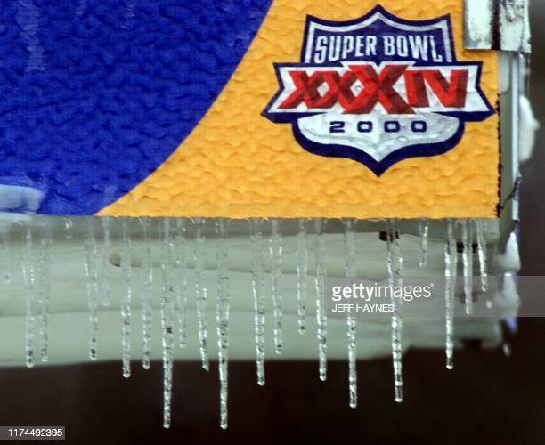Icicles hang from a sign 29 January2000 outside the the Georgia Dome in Atlanta Georgia the site of Super Bowl XXXIV The Tennessee Titans will play...