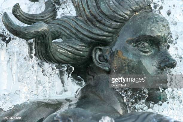 Icicles hang from a statue in the fountains of Trafalgar Square on February 10, 2021 in London, England. Heavy snow brings a week of freezing...