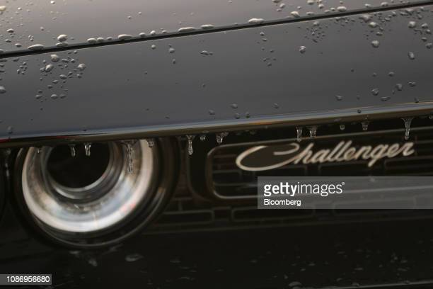 Icicles hang from an imported Dodge Challenger automobile at the BLG Logistics Group AG terminal at the Port of Bremerhaven in Bremerhaven, Germany,...