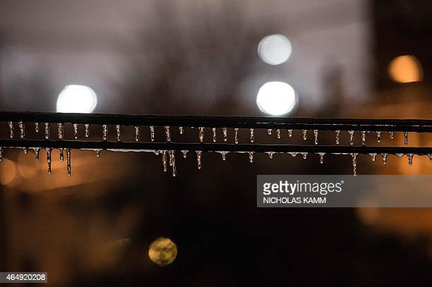Icicles hang from cables in Washington on March 1 2015 after sleet fell on the US capital AFP PHOTO/NICHOLAS KAMM