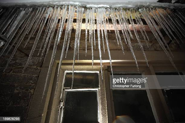 Icicles hang from the roof of a cottage in the village of Tissington Derbyshire on January 21 2013 in Ashbourne United Kingdom The Met Office has...