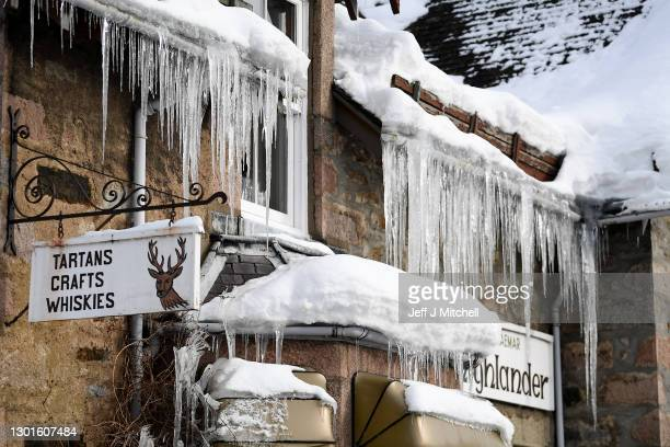 Icicles hang from the roof of a shop on February 11, 2021 in Braemar, Scotland. A low of -22.9C was recorded overnight in the Scottish Highlands by...