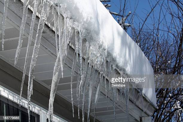 icicles on the roof - icicle stock pictures, royalty-free photos & images
