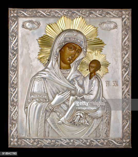 Icon 19th century Rectangular wooden icon of The Virgin Hodegetria Virgin facing right and Child silver cover garland border in field two floral...