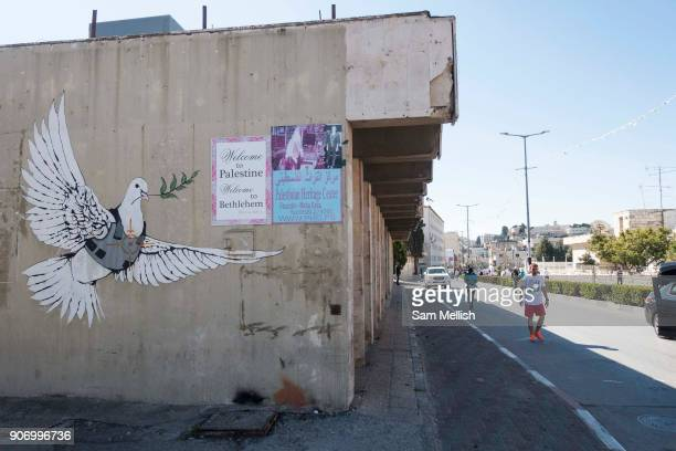 Iconic Banksy street art picturing a white dove with an olive branch in Bethlehem on 1st April 2016 in Bethlehem West Bank During the Palestine...