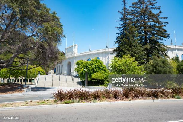 Iconic California Memorial Stadium among trees in the Berkeley Hills on a sunny day on the main campus of UC Berkeley in downtown Berkeley,...