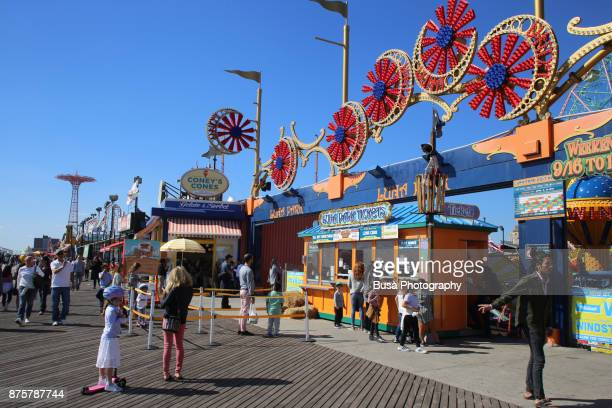 Iconic colored signage and ticket booth at the boardwalk entrance of Luna Park, the new amusement park at Coney Island, Brooklyn, New York City