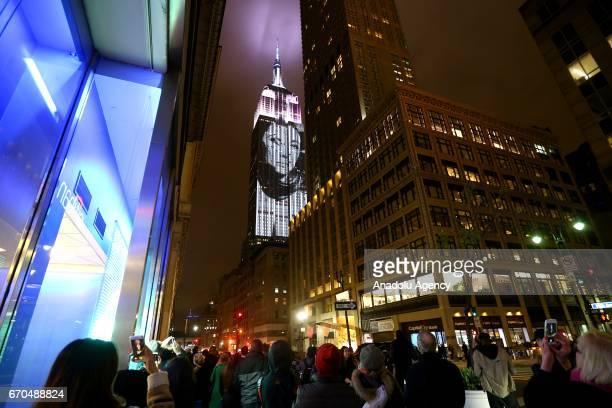 Iconic covers of the history of Harpers Bazaar fashion magazine are projected on the Empire State Building during the celebrations of the 150th...