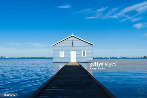 iconic crawley edge blue boat shed on swan river in perth, australia - perth stock pictures, royalty-free photos & images