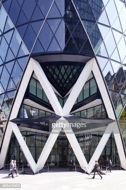Iconic Entrance to the Gherkin with office workers passing by Office Space at The Gherkin London United Kingdom Architect IOR GROUP Interiors Foster...