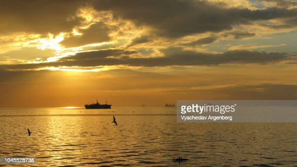 iconic manila sunset - argenberg stock pictures, royalty-free photos & images