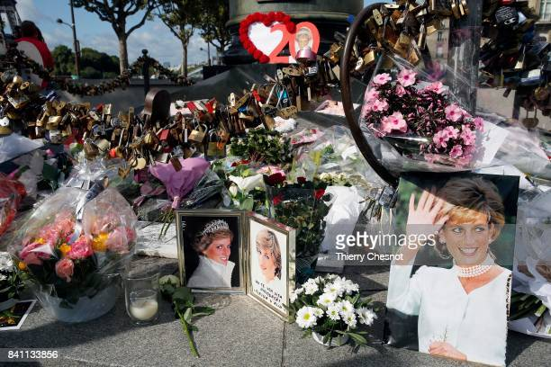 Iconic photos flowers and messages dedicated to pay homage to Lady Diana to the 20th anniversary of her death adorn the plinth of the Flame of...