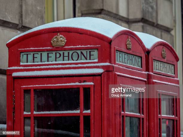 Iconic red telephone boxes covered with snow in London, UK