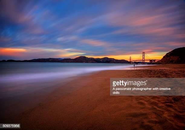 Iconic View Of Golden Gate Bridge And Surrounding Beach