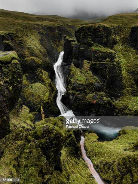 Iconic view of the fjaðrárgljúfur canyon during moody weather, Iceland
