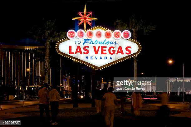 Iconic Welcome to Fabulous Las Vegas Nevada sign at nigths with Las Vegas Boulevard in the back