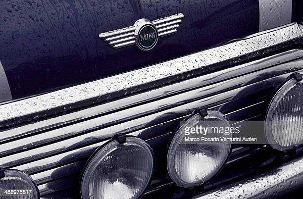 iconic wet mini car - mini cooper stock pictures, royalty-free photos & images