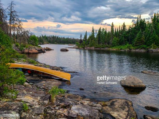 iconic wilderness canoeing scene - ontario canada stock pictures, royalty-free photos & images