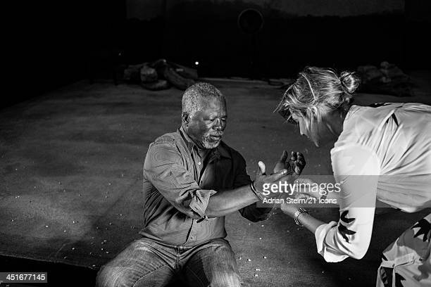21 Icons creative director Harriet Pratten assists John Kani during his 21 Icons portrait shoot at the Market Theatre on October 14 2012 in...