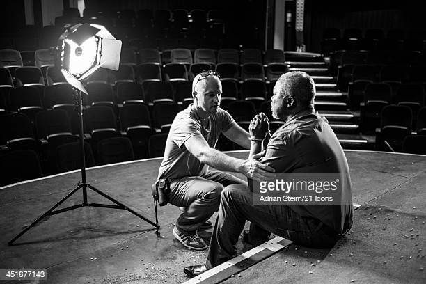 21 Icons DoP Damon Hyland assists John Kani during his 21 Icons portrait shoot at the Market Theatre on October 14 2012 in Johannesburg South Africa...