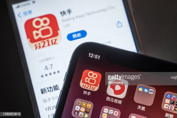 Icons for the Kuaishou Technology app, top left, and ByteDance Ltd.'s Xigua Video app, top second left, on a smartphone arranged in Hong Kong, China,...