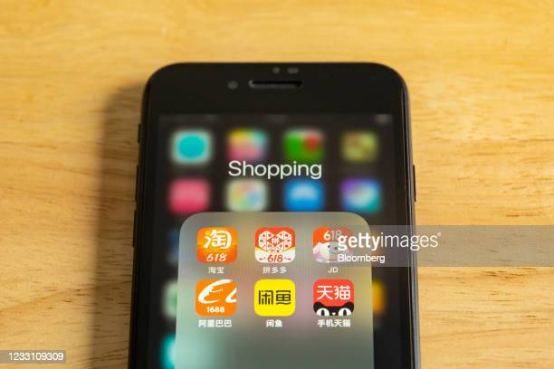 Icons of e-commerce platform applications are arranged, clockwise from top left, Alibaba Group Holding Ltd.'s Taobao, Pinduoduo Inc., JD.Com,...