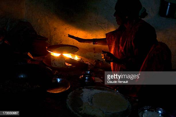 CONTENT] ICooking chapatis in a kitchen in Gulbarga a town of karnataka