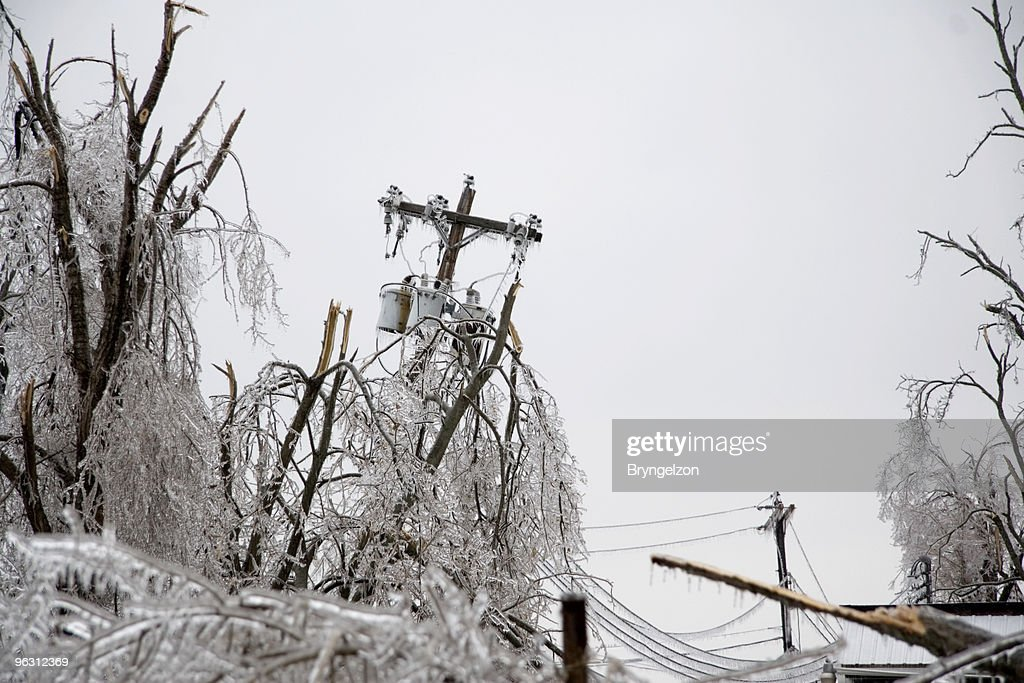 Icy Power Pole Falling : Stock Photo