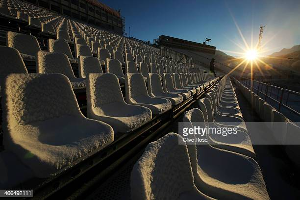 Icy spectator seats are pictured at the finish area of the Alpine Skiing ahead of the Sochi 2014 Winter Olympics at the Rosa Khutor Alpine Center,...
