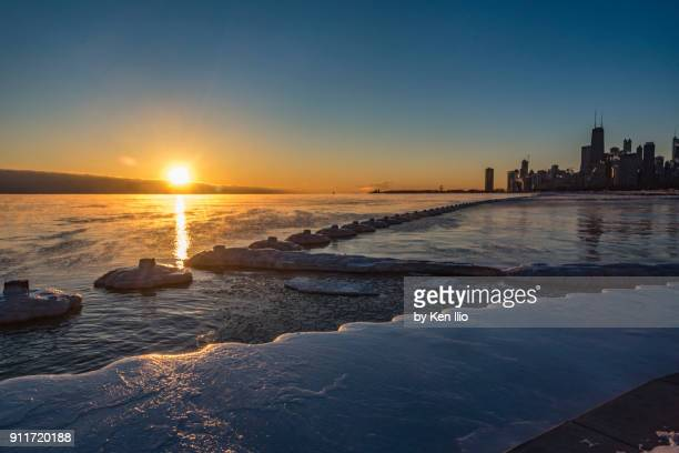 icy sunrise - ken ilio stock pictures, royalty-free photos & images
