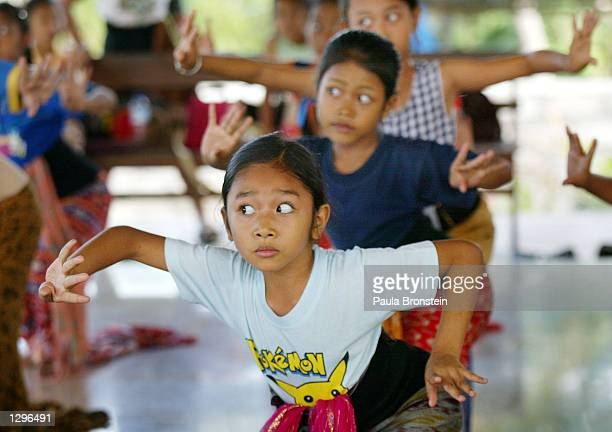 Ida Ayu Nindia Patanjali a student with three years experience practices her Legong dance movements August 62002 in Amlapura Bali Indonesia during an...
