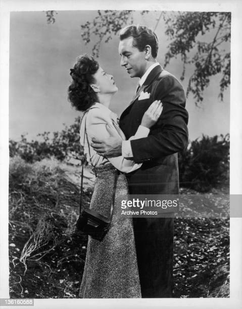 Ida Lupino looking up at Paul Henreid as they embrace one another in a scene from the film 'In Our Time' 1944
