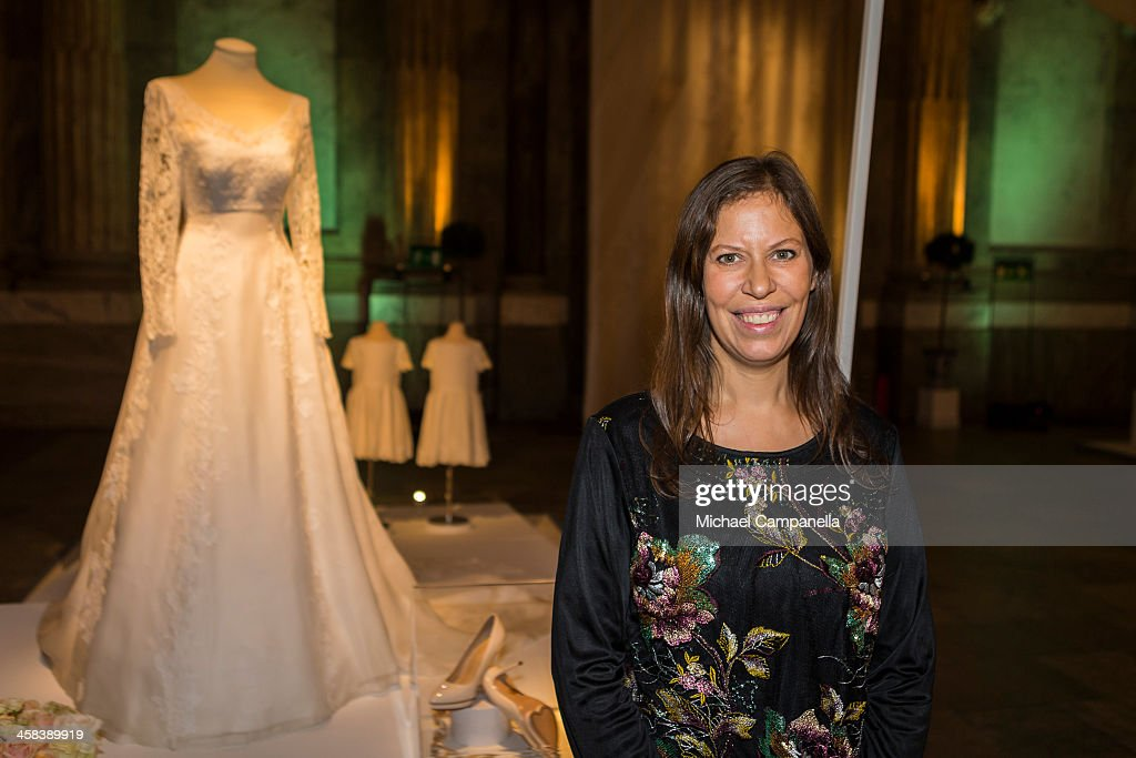 Ida Sjöstedt poses for a portrait in front of the wedding dress she designed for Princess Sofia of Sweden which is on display during an exhibition at the Royal Palace on October 17, 2016 in Stockholm, Sweden.