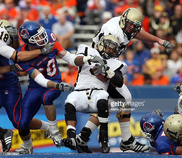 Idaho defensive back Breyon Williams falls for a couple more yards in the first half against Boise State on Saturday November 17 at Bronco Stadium in...