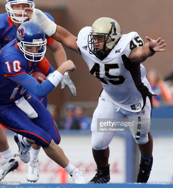 Idaho linebacker Jonathan Faraimo reaches for Boise State quarterback Taylor Tharp in the first half on Saturday November 17 at Bronco Stadium in...