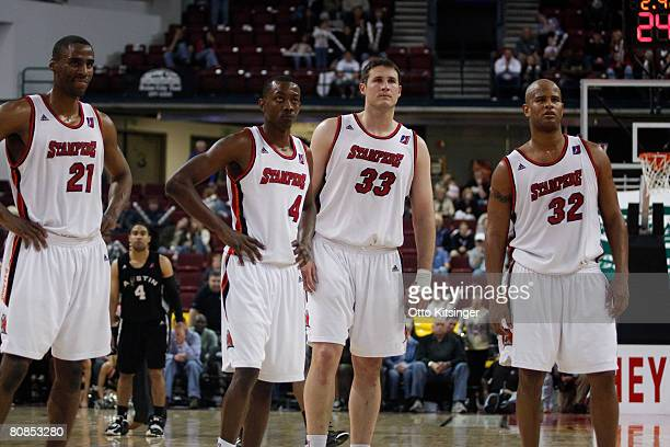 Idaho Stampede teammates Jason Ellis Mike Taylor Cory Violette and Randy Livingston watch a free throw by the Austin Toros during Game Two of the...