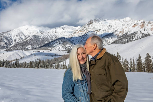 USA, Idaho, Sun Valley, Winter portrait of senior couple in front of Boulder Mountains