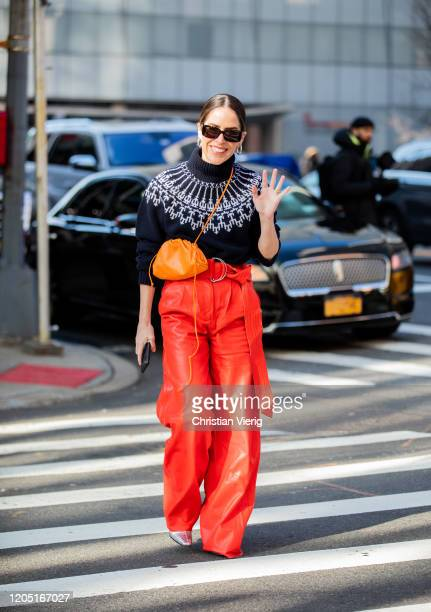 Idalia Salsamendi is seen wearing navy turtleneck, red high waist pants outside Tory Burch during New York Fashion Week Fall / Winter on February 09,...