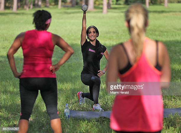 Idalis Velazquez, center, teaches a fitness class in Fern Glen Park in Coral Springs, Fla., on July 14, 2014.
