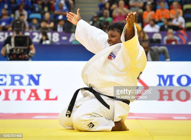 Idalys Ortiz from Cuba celebrates her victory over Maria Suelen Altheman from Brazil in the women's over 78kg category semifinal bout of the 2018...