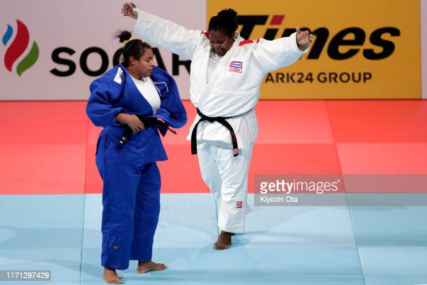 Idalys Ortiz of Cuba celebrates her victory over Maria Suelen Altheman of Brazil in the Women's +78kg semi final on day seven of the World Judo...