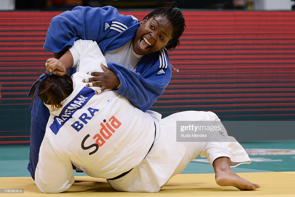 Idalys Ortiz (blue) of Cuba competes with Maria Altheman of Brazil during the +78kg category woman final of the IJF World Judo Championship at Gymnasium Maracanazinho on August 31, 2013 in Rio de Janeiro, Brazil.