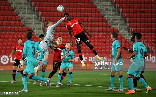 Iddrisu Babav of RCD Mallorca battles for possession with MarcAndre ter Stegen of FC Barcelona during the La Liga match between RCD Mallorca and FC...
