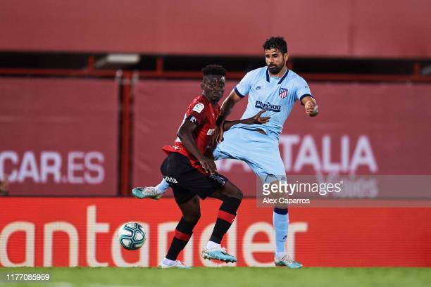 Iddrisu Mohamed Baba of RCD Mallorca protects the ball from Diego Costa of Atletico de Madrid during the La Liga match between RCD Mallorca and Club...
