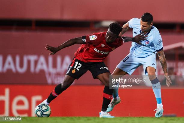 Iddrisu Mohamed Baba of RCD Mallorca protects the ball from Victor Machin 'Vitolo' of Atletico de Madrid during the La Liga match between RCD...