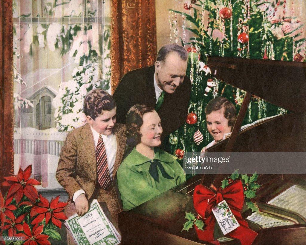 Family Gathered Around Piano : News Photo