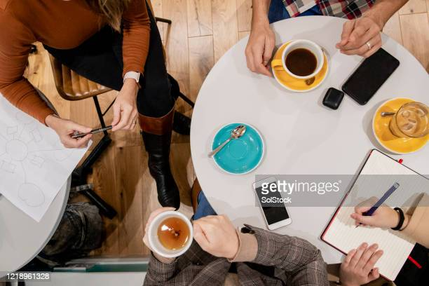ideas over coffee - looking down stock pictures, royalty-free photos & images