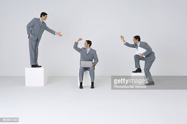 identical businessmen congratulating each other - cloning stock pictures, royalty-free photos & images