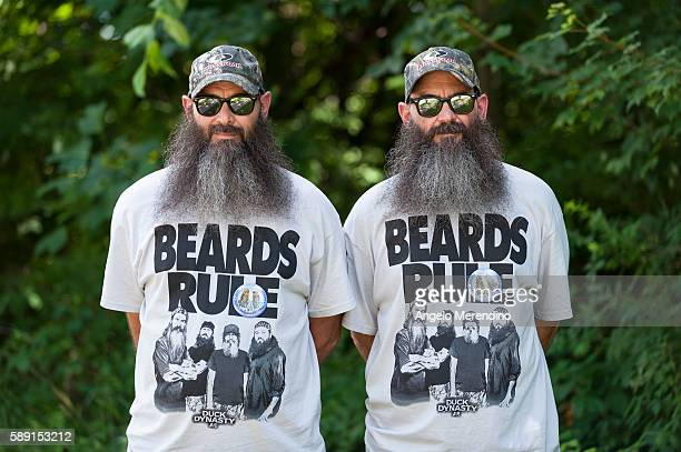 Identical twin brothers Charles and Ron Stevenson from Titusville Pennsylvania pose for a portrait on August 3 2013 at The Twins Day Festival in...