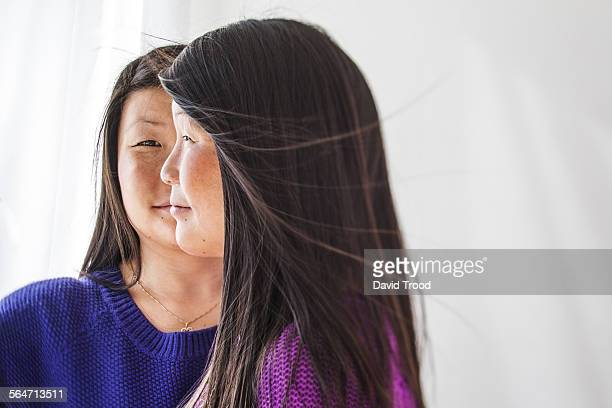 identical twin sisters - asian twins stock photos and pictures